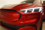 This Wednesday, Oct. 30, 2019 photo shows the front headlights of the new Ford Mustang Mach-E SUV in Warren, Mich. Ford is hoping to score big with the electric SUV for daily drivers that sort of looks like a Mustang performance car. The new SUV, to be unveiled just ahead of the Los Angeles Auto Show press days, should have range of up to 300 miles. It's one of dozens of electric vehicles coming globally by 2022. Automakers are eyeing what they think will be a growing market in the years to come.  (AP Photo/Carlos Osorio)