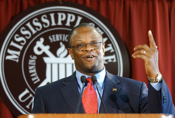 FILE - In this Dec. 2, 2003, file photo, newly hired Mississippi State head football coach Sylvester Croom gestures during a press conference in Starkville, Miss. Croom, who became the first Black head football coach in SEC history when he was hired by Mississippi State, said the NCAA's recent trend toward making it easier for athletes to transfer schools and gain immediate eligibility has helped them find their voice.(AP Photo/Rogelio Solis, File)