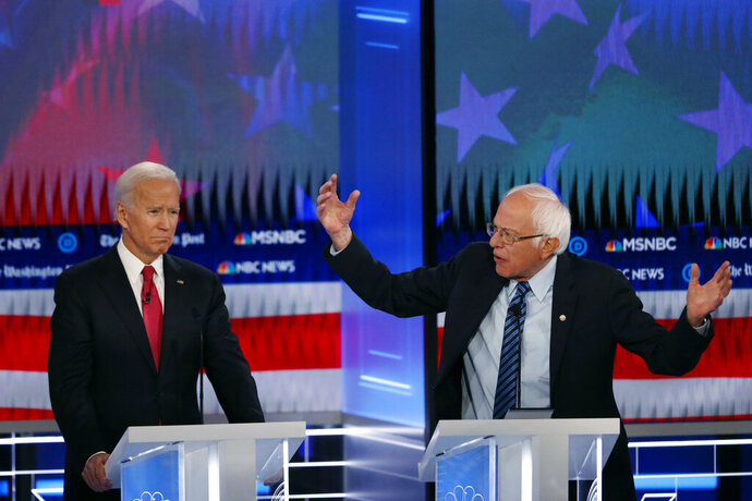 Democratic presidential candidate Sen. Bernie Sanders, I-Vt., speaks as Democratic presidential candidate former Vice President Joe Biden listens during a Democratic presidential primary debate, Wednesday, Nov. 20, 2019, in Atlanta. (AP Photo/John Bazemore)