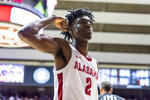 Alabama guard Kira Lewis Jr. (2) flexes after a score against Auburn during the second half of an NCAA college basketball game Wednesday, Jan. 15, 2020, in Tuscaloosa, Ala. (AP Photo/Vasha Hunt)