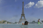 People cool off in the fountain of the Trocadero, in Paris, Tuesday, June 25, 2019. Authorities warned that temperatures could top 40 degrees Celsius (104 Fahrenheit) in some parts of Europe over the coming days, the effect of hot air moving northward from Africa. French Health Minister Agnes Buzyn said more than half of France is on alert for high temperatures Tuesday and the hot weather is expected to last until the end of the week. (AP Photo/Alessandra Tarantino)