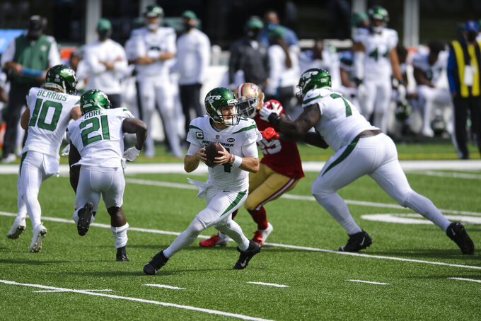 New York Jets quarterback Sam Darnold (14) looks to pass during the first half of an NFL football game against the San Francisco 49ers, Sunday, Sept. 20, 2020, in East Rutherford, N.J. (AP Photo/Bill Kostroun)