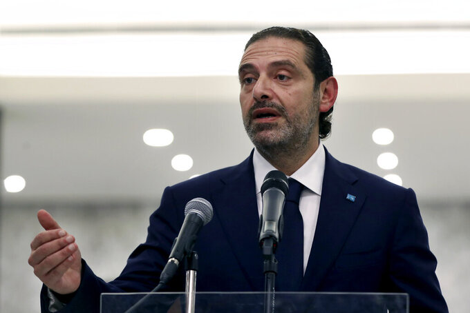 Lebanese Prime Minister-Designate Saad Hariri, speaks to journalists after his meeting with Lebanese President Michel Aoun, at the Presidential Palace in Baabda, east of Beirut, Lebanon, Thursday, March 18, 2021. Hariri said despite disagreements with the country's president there is still a chance to form a government to halt economic collapse and offer people hope. (AP Photo/Bilal Hussein)