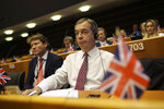 Brexit Party leader Nigel Farage listens to European Commission President Jean-Claude Juncker addressing European lawmakers at the European Parliament in Brussels, Wednesday, Oct. 9, 2019. (AP Photo/Francisco Seco)