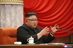 """In this photo provided by the North Korean government, North Korean leader Kim Jong Un speaks during the ruling party congress in Pyongyang, North Korean, Sunday, Jan. 10, 2021. Kim was given a new title, """"general secretary"""" of the ruling Workers' Party, formerly held by his late father and grandfather, state media reported Monday, Jan. 11, in what appears to a symbolic move aimed at bolstering his authority amid growing economic challenges. Independent journalists were not given access to cover the event depicted in this image distributed by the North Korean government. The content of this image is as provided and cannot be independently verified. Korean language watermark on image as provided by source reads:"""