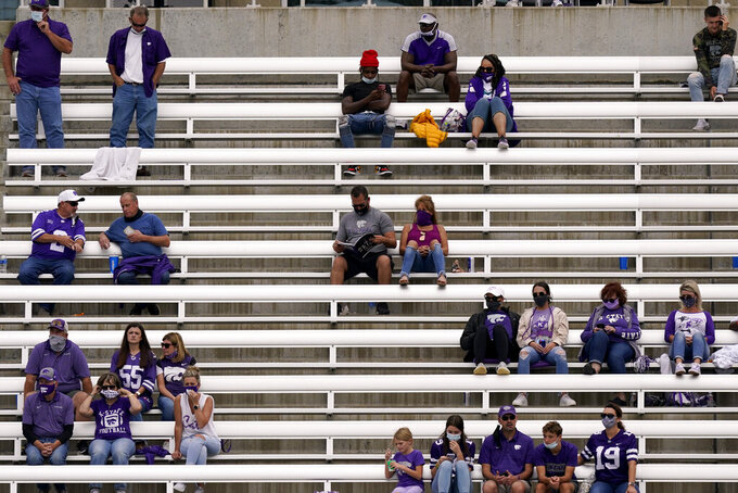 Fans are socially distanced as they watch the first half of an NCAA college football game between Kansas State and Arkansas State, Saturday, Sept. 12, 2020, in Manhattan, Kan. (AP Photo/Charlie Riedel)