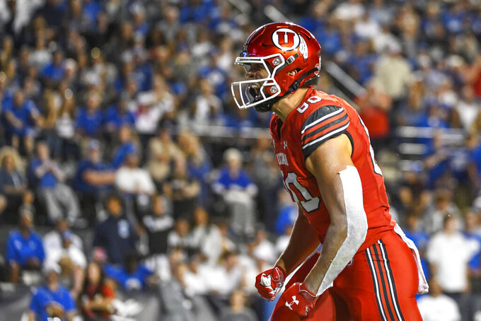 Utah tight end Brant Kuithe (80) celebrates a touchdown during the first half of an NCAA college football game against Brigham Young Saturday, Sept. 11, 2021, in Provo, Utah. (AP Photo/Alex Goodlett)