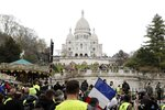 Protesters take part in a rally under the Basilica of the Sacred Heart of Paris in Montmartre, Saturday, March 23, 2019. The French government vowed to strengthen security as yellow vest protesters stage a 19th round of demonstrations, in an effort to avoid a repeat of last week's riots in Paris. (AP Photo/Kamil Zihnioglu)