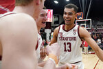 Stanford forward Oscar da Silva (13) celebrates with teammates after a 70-60 victory against Oregon in an NCAA college basketball game Saturday, Feb. 1, 2020, in Stanford, Calif. (AP Photo/Tony Avelar)