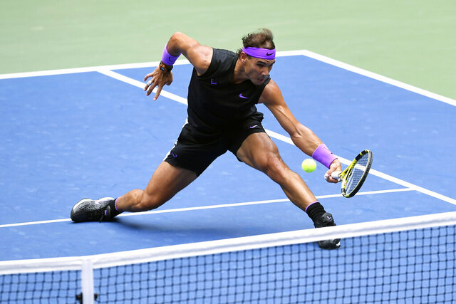 FILE - In this Sept. 8, 2019, file photo, Rafael Nadal, of Spain, returns a shot to Daniil Medvedev, of Russia, during the men's singles final of the U.S. Open tennis championships in New York. Defending champion Rafael Nadal will skip the U.S. Open because of the coronavirus pandemic. (AP Photo/Sarah Stier, File)