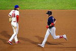 Boston Red Sox's Bobby Dalbec, right, rounds the bases past Philadelphia Phillies third baseman Alec Bohm after hitting a two-run home run off pitcher David Phelps during the sixth inning of the second baseball game in a doubleheader, Tuesday, Sept. 8, 2020, in Philadelphia. (AP Photo/Matt Slocum)