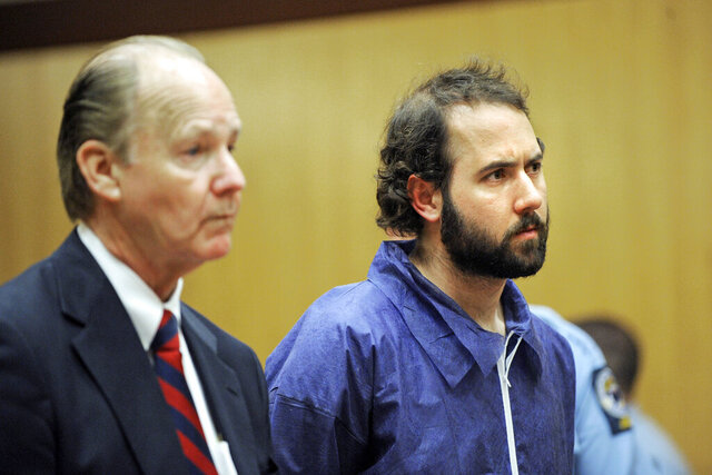 FILE — In this May 8, 2009 file photo, Stephen P. Morgan, right, and his attorney Richard Brown, listen to judge Mary-Margaret Burgdorff in Middletown Superior Court in Middletown, Conn. Morgan, a Massachusetts man acquitted by reason of insanity of killing a Wesleyan University student in 2009, has filed a lawsuit against Connecticut's state psychiatric hospital complex, saying an employee improperly told a TV station that he and other patients were allowed to play violent video games. (AP Photo/Fred Beckham, Pool, File)