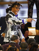 Carolina Panthers quarterback Cam Newton arrives for the NFL Honors football award show Saturday, Feb. 1, 2020, in Miami. (AP Photo/David J. Phillip)