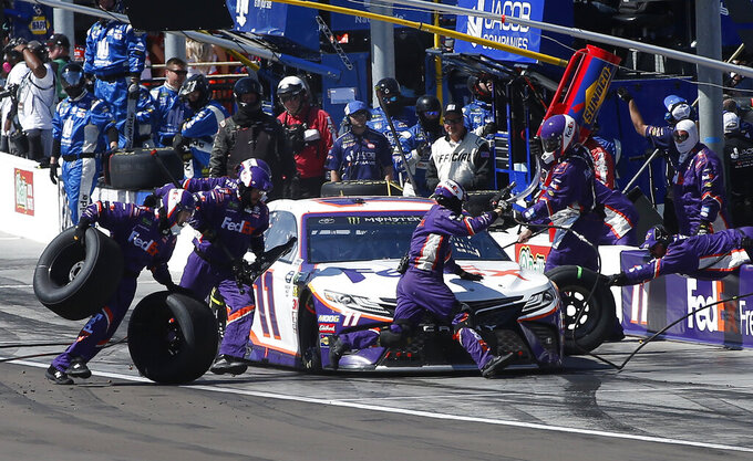 Denny Hamlin makes a pit stop on lap 66 during the NASCAR Cup Series auto race at ISM Raceway, Sunday, March 10, 2019, in Avondale, Ariz. (AP Photo/Ralph Freso)