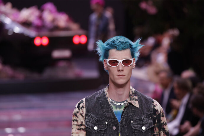 A model wears a creation as part of the Versace men's Spring-Summer 2020 collection, unveiled during the fashion week, in Milan, Italy, Saturday, June 15, 2019. (AP Photo/Luca Bruno)