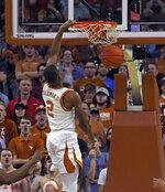 Texas guard Matt Coleman, III dunks the ball during the first half of an NCAA college basketball game against Texas Tech, Saturday, Jan. 12, 2019, in Austin, Texas. (AP Photo/Michael Thomas)