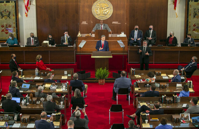 North Carolina Governor Roy Cooper delivers his State of the State address before a joint session of the North Carolina House and Senate on Monday, April 26, 2021 in Raleigh, N.C. (Robert Willett/The News & Observer via AP)
