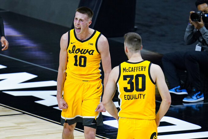 Iowa guard Joe Wieskamp (10) celebrates with guard Connor McCaffery (30) after blocking a shot in the closing minute of the team's NCAA college basketball game against Wisconsin at the Big Ten Conference men's tournament in Indianapolis, Friday, March 12, 2021. Iowa won 62-57. (AP Photo/Michael Conroy)