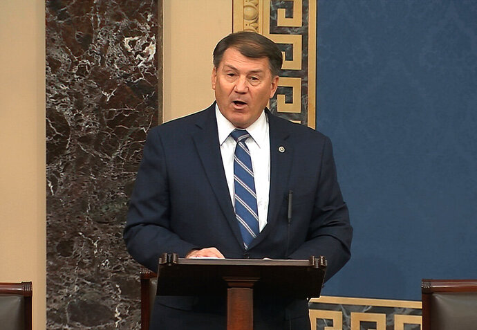 FILE - In this file image from Feb. 4, 2020, video, Sen. Mike Rounds, R-S.D., speaks on the Senate floor about the impeachment trial against President Donald Trump at the U.S. Capitol in Washington. Poll workers will attempt to space voters apart Tuesday, June 1, during South Dakota's primary election, although there's a good chance most ballots will have already been submitted ahead of in-person voting. (Senate Television via AP, File)