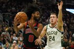 Chicago Bulls' Coby White tries to drive past Milwaukee Bucks' Pat Connaughton during the second half of an NBA basketball game Thursday, Nov. 14, 2019, in Milwaukee. The Bucks won 124-115. (AP Photo/Morry Gash)