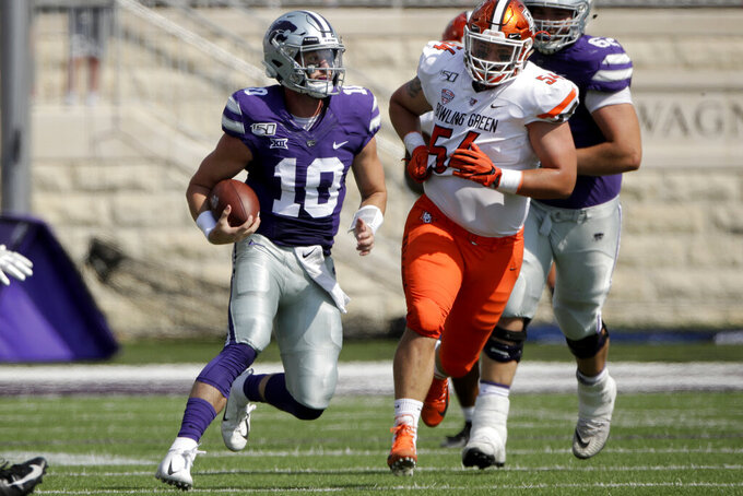 Kansas State quarterback Skylar Thompson (10) gets past Bowling Green defensive lineman Nico Lautanen (54) during the first half of an NCAA college football game Saturday, Sept. 7, 2019, in Manhattan, Kan. (AP Photo/Charlie Riedel)