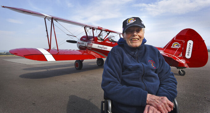 Arnold Peterson, a 99-year-old Navy veteran, received a flight in a Boeing-Stearman Model 75 biplane at Glacier International Airport on Thursday, Aug. 26, 2021, as part of nonprofit Dream Flights' Operation September Freedom, which honors World War II veterans. (Jeremy Weber/Daily Inter Lake via AP)