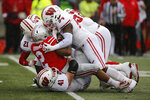 Ohio State running back J.K. Dobbins (2) is tackled by Wisconsin defenders during the first half of an NCAA college football game Saturday, Oct. 26, 2019, in Columbus, Ohio. (AP Photo/Jay LaPrete)