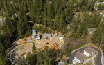 In this March 14, 2019, photo, a housing development off Chief Kelly Drive in Nevada City, Calif., is under construction. California cities continue to build homes in areas of high wildfire risk. City officials agree that the wooded draws, steep hillsides, narrow residential streets, ancient homes and thick urban tree canopy that define the character of the city also make it particularly at risk if a fire burns through. (Hector Amezcua/The Sacramento Bee via AP)