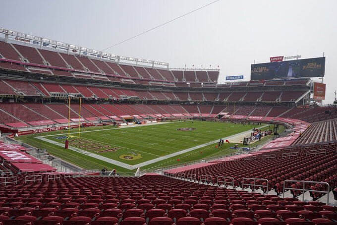 San Francisco 49ers players and coaches stand in the far end zone during a presentation on social justice at Levi's Stadium before an NFL football game between the 49ers and the Arizona Cardinals in Santa Clara, Calif., Sunday, Sept. 13, 2020. (AP Photo/Jeff Chiu)