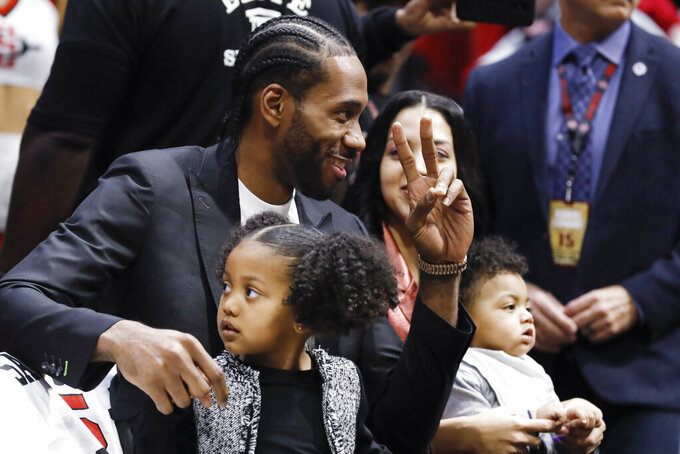 Former San Diego State forward Kawhi Leonard, now with the Los Angeles Clippers, reacts during the first half of San Diego State's NCAA college basketball game against Utah State on Saturday, Feb. 1, 2020, in San Diego. (AP Photo/Gregory Bull)