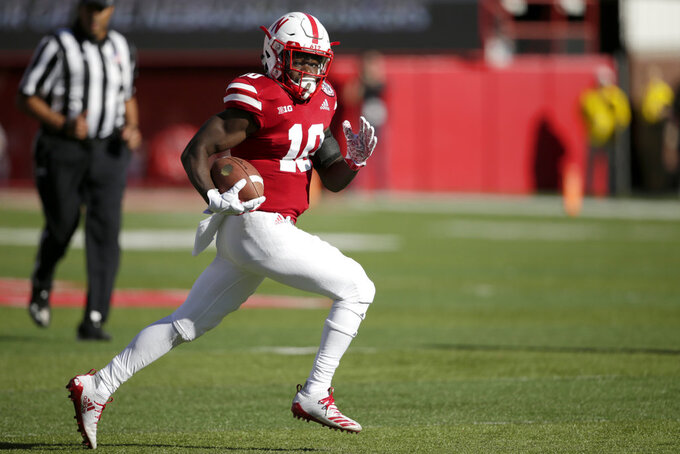 Nebraska wide receiver JD Spielman (10) returns a kick for a touchdown during the first half of an NCAA college football game against Bethune-Cookman in Lincoln, Neb., Saturday, Oct. 27, 2018. (AP Photo/Nati Harnik)