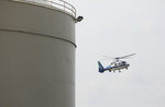 A Lifeflight helicopter lands at the Andersons following an accident where two workers died after they were trapped in a silo filled with grain, Friday, July 19, 2019 in Toledo, Ohio.  The workers became trapped Friday morning inside the silo operated by The Andersons. (Dave Zapotosky /The Blade via AP)