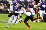 Minnesota Vikings wide receiver Stefon Diggs, left, fumbles as he is hit by Chicago Bears cornerback Prince Amukamara during the first half of an NFL football game Sunday, Sept. 29, 2019, in Chicago. The Bears recovered the fumble. (AP Photo/Matt Marton)