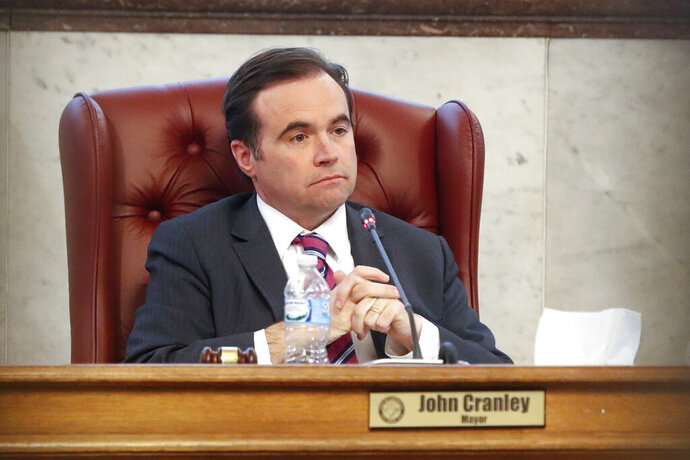 FILE - In this March 21, 2018, file photo, Cincinnati Mayor John Cranley listens during a city council meeting at city hall in Cincinnati. The Democrat announced on Friday, Feb. 14, 2020, that he is exploring a run for Ohio governor in 2022. (AP Photo/John Minchillo, File)
