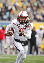Texas Tech quarterback Jett Duffey (7) carries the ball near the goal line during the second quarter of their NCAA college football game against West Virginia in Morgantown, W.Va., Saturday, Nov. 9, 2019. (AP Photo/Chris Jackson)