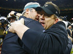 New Orleans Saints head coach Sean Payton, right, speaks with Philadelphia Eagles head coach Doug Pederson after an NFL divisional playoff football game in New Orleans, Sunday, Jan. 13, 2019. The Saints won 20-14 to advance to the NFC Championship. (AP Photo/Butch Dill)