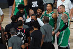 Boston Celtics guard Marcus Smart (36) exchanges works with members of th eToronto Raptors following an NBA conference semifinal playoff basketball game Wednesday, Sept. 9, 2020, in Lake Buena Vista, Fla. The Raptors defeated the Celtics 125-122. (AP Photo/Mark J. Terrill)