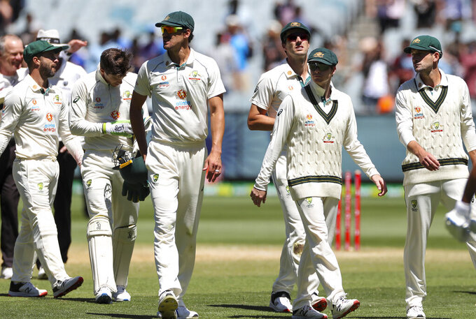 Australian players leave the field after losing the second cricket test against India at the Melbourne Cricket Ground, Melbourne, Australia, Tuesday, Dec. 29, 2020. India defeated Australia by eight wickets to level the series at 1-1. (AP Photo/Asanka Brendon Ratnayake)