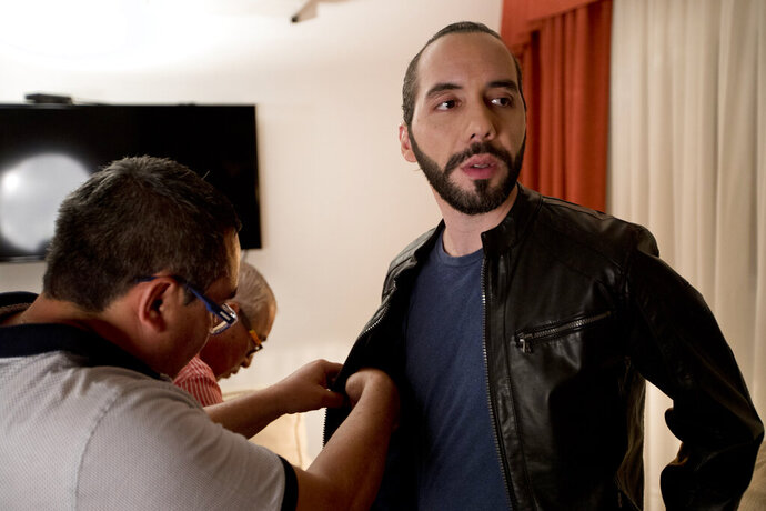 Presidential frontrunner Nayib Bukele, of the Grand National Alliance for Unity or GANA, is prepped for an interview, in San Salvador, El Salvador, Tuesday, Jan. 29, 2019. The young entrepreneur has his sights set on combating corruption and promises to create an anti-corruption commission similar to its Central American neighbors. Salvadorans go to the polls this Sunday. (AP Photo/Moises Castillo)