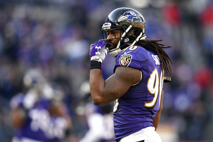 FILE - In this Jan. 6, 2019, file photo, Baltimore Ravens outside linebacker Za'Darius Smith walks on the field during the second half of an NFL wild card playoff football game against the Los Angeles Chargers in Baltimore. With unrestricted free agent linebackers C.J. Mosley, Terrell Suggs and Za'Darius Smith headed elsewhere after the release last week of safety Eric Weddle, the Ravens lost four key contributors while adding much-needed salary cap space. (AP Photo/Nick Wass, File)