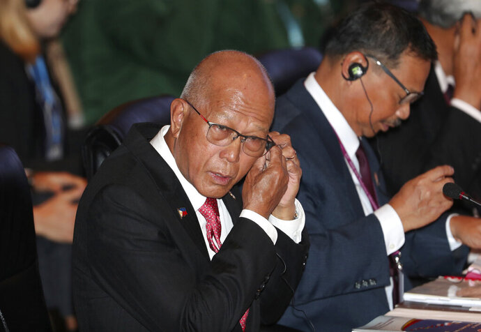 FILE - In this July 11, 201, file photo, Philippine Defense Secretary Delfin Lorenzana attends ASEAN defense ministers meeting in Bangkok, Thailand. Lorenzana has asked Beijing to explain the activities of Chinese research vessels and warships in what the Philippines claims as its waters. (AP Photo/Sakchai Lalit, File)