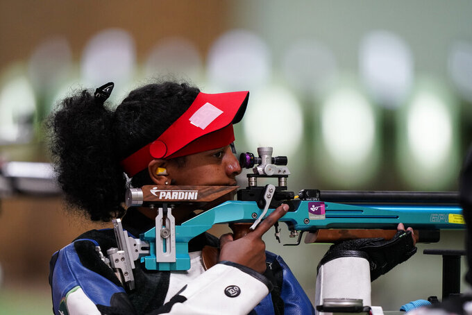 Luna Solomon, of Refugee Olympic Team, competes in the women's 10-meter air rifle at the Asaka Shooting Range in the 2020 Summer Olympics, Saturday, July 24, 2021, in Tokyo, Japan. (AP Photo/Alex Brandon)