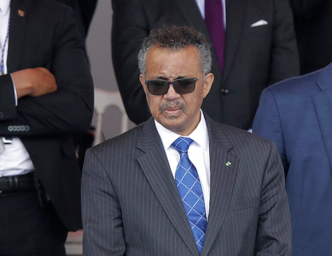 FILE - In this file photo dated Tuesday, July 14, 2020, Director General of the World Health Organization, Tedros Adhanom Ghebreyesus, attends the Bastille Day military parade, in Paris.  The head of the World Health Organization has appealed Wednesday Aug. 4, 2021, for a moratorium on administering booster shots of COVID-19 vaccines, to ensure doses are available in countries where few people have yet received their first shots. (AP Photo/Christophe Ena, FILE)