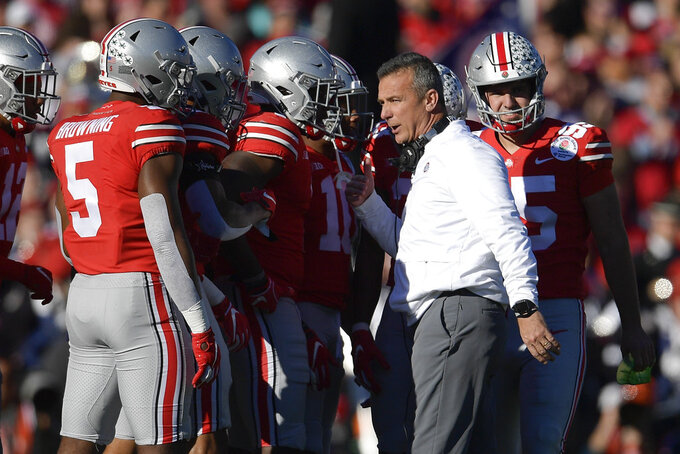Ohio State head coach Urban Meyer talks with his team during the first half of the Rose Bowl NCAA college football game Washington Tuesday, Jan. 1, 2019, in Pasadena, Calif. (AP Photo/Mark J. Terrill)