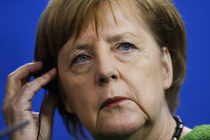 German Chancellor Angela Merkel attends a joint news conference with the President of Burkina Faso Roch Marc Christian Kabore after a meeting at the chancellery in Berlin, Germany, Thursday, Feb. 21, 2019. (AP Photo/Markus Schreiber)