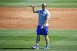 FILE - In this Friday, July 3, 2020, file photo, Chicago Cubs manager David Ross gestures during baseball practice at Wrigley Field in Chicago. Ross and other first-year managers are scrambling to make up for lost time. The rookie skippers are getting creative when it comes to getting a feel for their players during a season unlike any other.  (AP Photo/Kamil Krzaczynski, File)