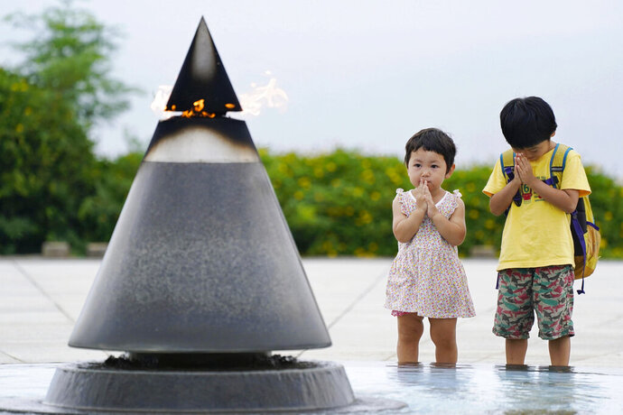 Children pray in front of the