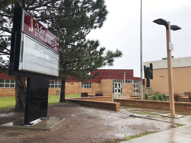 FILE - This June 20, 2019 file photo shows McCormick Junior High School, in Cheyenne, Wy. An investigation into racist and anti-LGBTQ leaflets at the Wyoming junior high has been released after a court battle with media outlets. (AP Photo/Mead Gruver,File)
