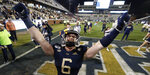 Georgia Tech linebacker David Curry celebrates after the team's 28-26 win over North Carolina State in an NCAA college football game Thursday, Nov. 21, 2019, in Atlanta. (AP Photo/John Bazemore)
