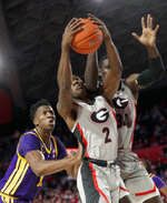 Georgia's Jordan Harris (2) and Mike Edwards (32) battle LSU forward Kavell Bigby-Williams (11) for a rebound during the second half of an NCAA college basketball game Saturday, Feb. 16, 2019, in Athens, Ga. (AP Photo/John Bazemore)